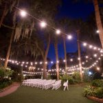 wedding ceremony at night with string lights