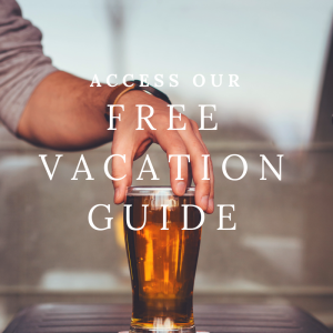 access our free vacation guide, photo of hand grabbing beer