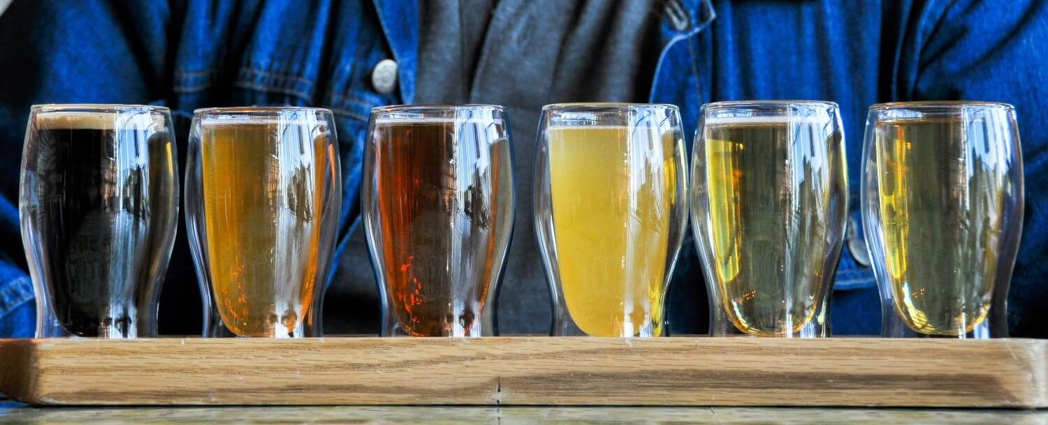 colorful flight of beer at first magnitude brewing company