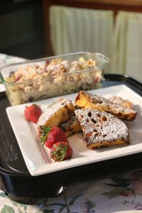 Delicious French toast with strawberries and powdered sugar
