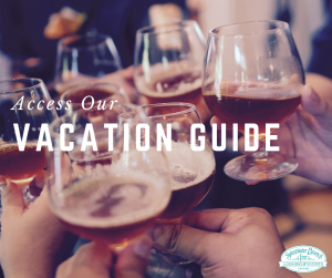text reads access our vacation guide. friends toasting with glasses of craft beer.