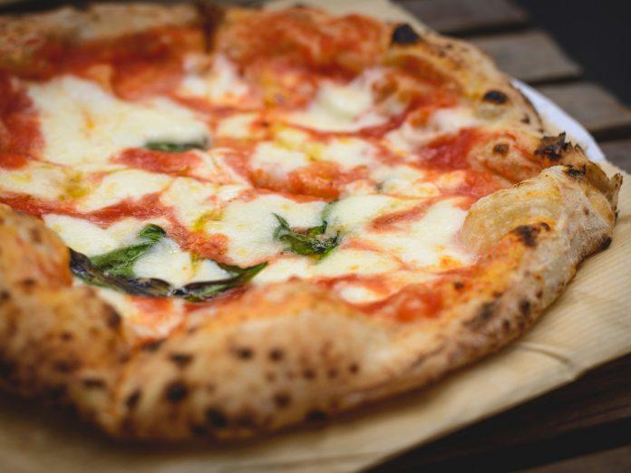 delicious pizza with tomato mozzarella basil