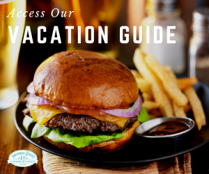 burger and fries at restaurant text reads access our vacation guide