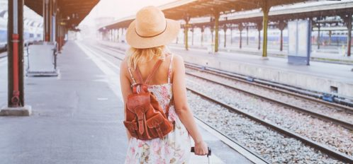 Woman with a suitcase enjoying the benefits to traveling midweek