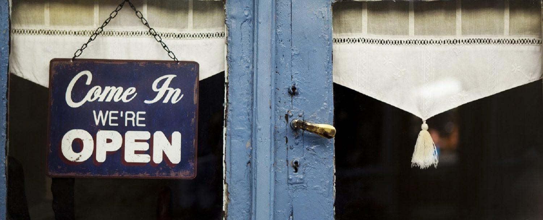 Open sign on the door of an old micanopy, fl, restaurant