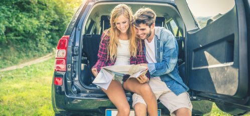 couple sitting in the car looking at a map