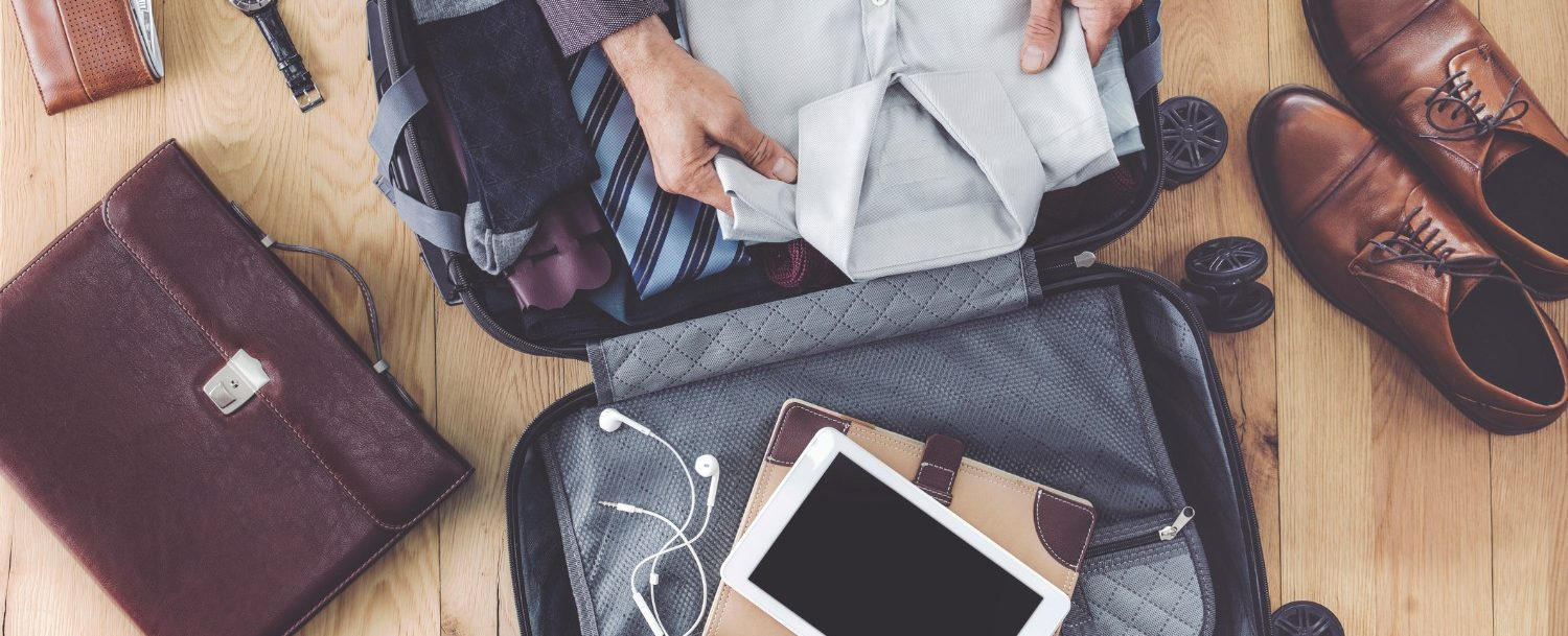 Business Traveler packing his suitace