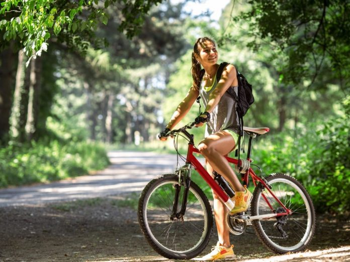 Woman biking in a state park near Gainesville