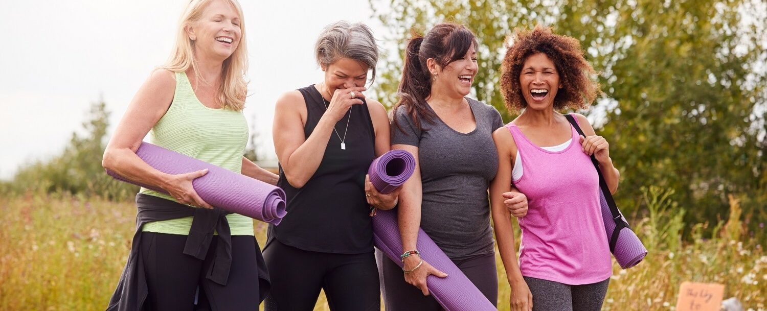group of women with yoga mats